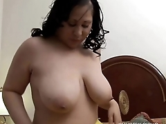 Beautiful busty brunette BBW fucks her soaking wet pussy