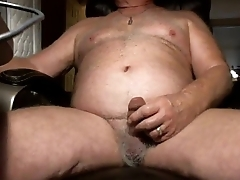 Handsome mature man wanking