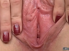 Lovesome cutie is gaping pink snatch in close range and having culminate