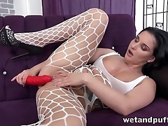 Mischievous gal in lingerie toys cunt with red-hot dildo